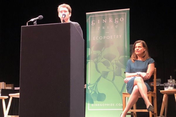 Jemma Borg reads onstage on at the Ginkgo Prize
